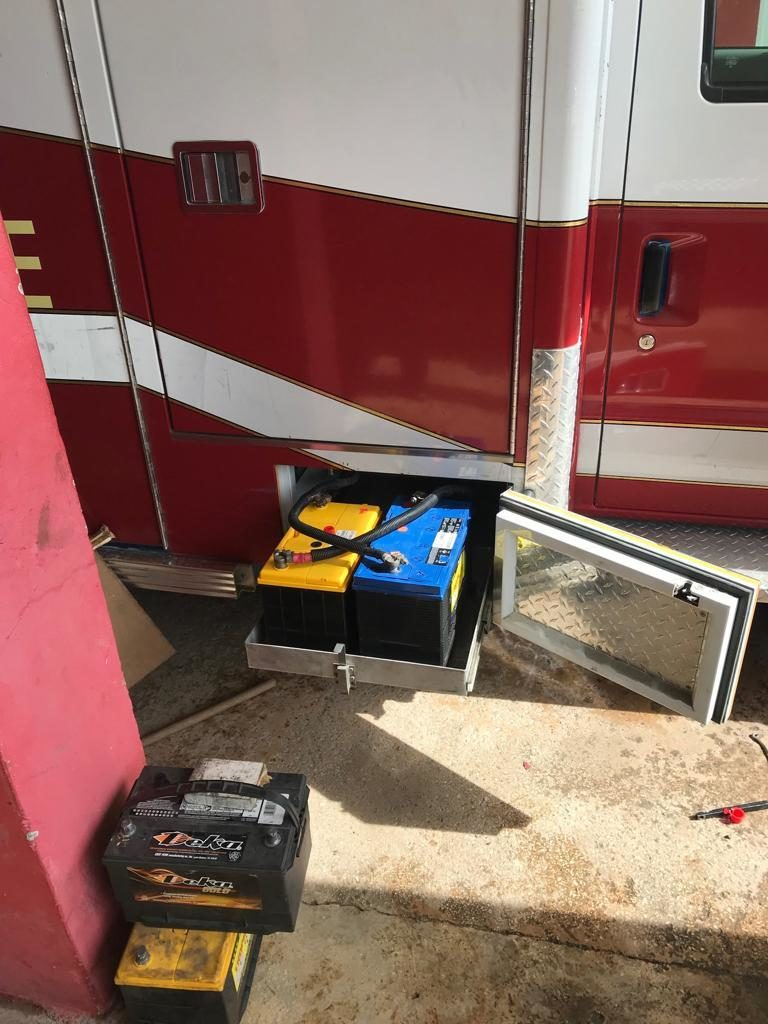 NCC purchased batteries for Negril Ambulance